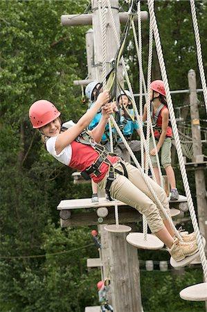 Boys and girls climbing crag, smiling Stock Photo - Premium Royalty-Free, Code: 6121-07741670