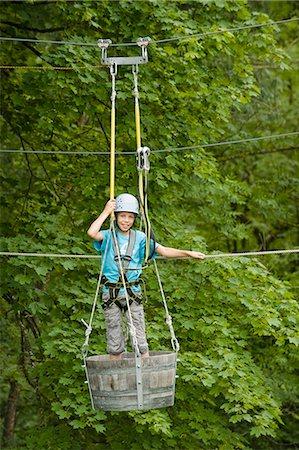 Portrait of boy climbing crag, smiling Stock Photo - Premium Royalty-Free, Code: 6121-07741689