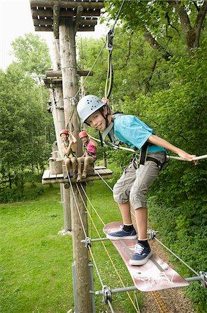 Boy and girls climbing crag, smiling Stock Photo - Premium Royalty-Free, Code: 6121-07741695