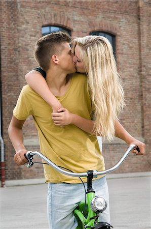Teenage couple kissing each other Stock Photo - Premium Royalty-Free, Code: 6121-07741602