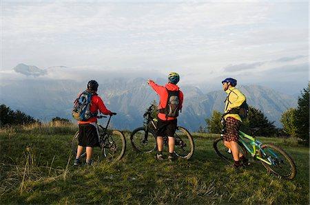 three mountain bikers looking at view, Kolovrat, Istria, Slovenia Stock Photo - Premium Royalty-Free, Code: 6121-07741756