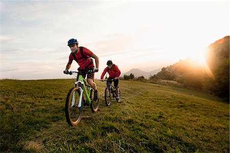 people and vacation - two mountain bikers on the way at sunset, Kolovrat, Istria, Slovenia Stock Photo - Premium Royalty-Free, Code: 6121-07741758