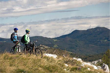 two mountain bikers looking at view, Vipava valley, Istria, Slovenia Stock Photo - Premium Royalty-Free, Code: 6121-07741771