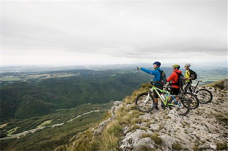 three mountain bikers looking at view, Vipava valley, Istria, Nanos, Slovenia Stock Photo - Premium Royalty-Free, Code: 6121-07741778