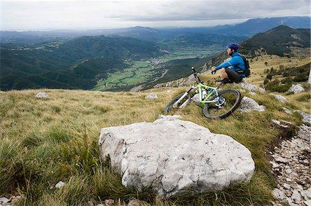 mountain biker having a rest, Vipava valley, Istria, Nanos, Slovenia Stock Photo - Premium Royalty-Free, Code: 6121-07741780