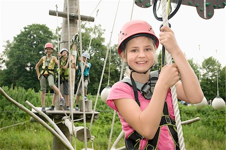 Girls and boys climbing crag, smiling Stock Photo - Premium Royalty-Free, Code: 6121-07741701