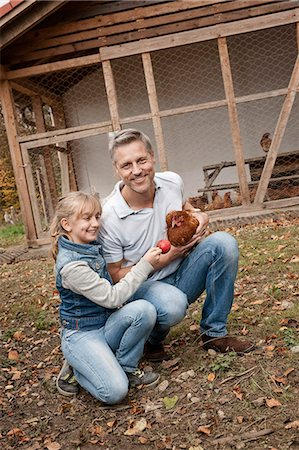 farming (raising livestock) - Father and daughter with chicken on organic farm Stock Photo - Premium Royalty-Free, Code: 6121-07741722