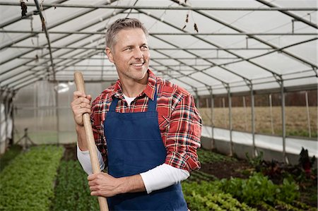 Smiling man in greenhouse Stock Photo - Premium Royalty-Free, Code: 6121-07741729