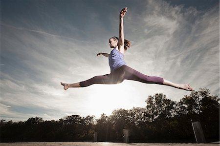Woman jumpingmid air, Woerthsee, Bavaria, Germany Stock Photo - Premium Royalty-Free, Code: 6121-07741857