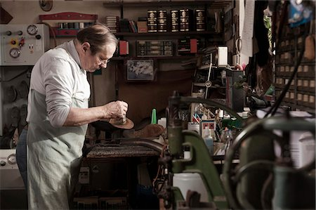Cobbler working in workshop Stock Photo - Premium Royalty-Free, Code: 6121-07741887