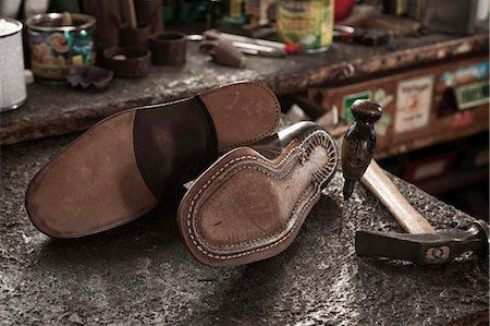 sole - Pair of leather shoes, awl and hammer in a cobbler's shop Stock Photo - Premium Royalty-Free, Code: 6121-07741899