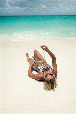 woman listening music on the beach, Koh Lipe, Thailand Stock Photo - Premium Royalty-Free, Code: 6121-07741956