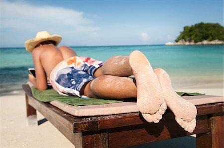 teenage boy hearing music at beach, Koh Lipe, Thailand Stock Photo - Premium Royalty-Free, Code: 6121-07741959