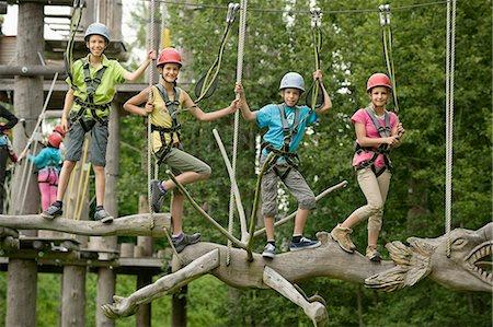 Childrens climbing on crag Stock Photo - Premium Royalty-Free, Code: 6121-07741926