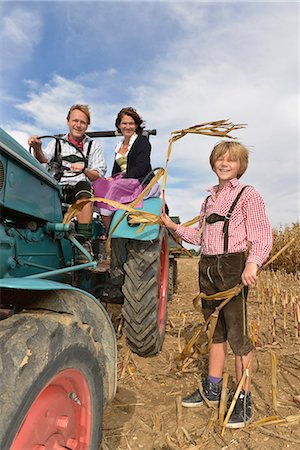Family on tractor in cornfield, Bavaria, Germany Stock Photo - Premium Royalty-Free, Code: 6121-07739941