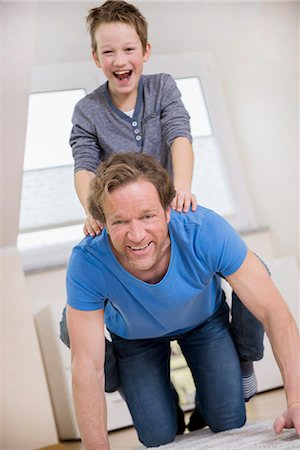 Playful father and son at home Stock Photo - Premium Royalty-Free, Code: 6121-07809678