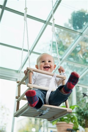 pantyhose kid - Portrait of laughing toddler sitting in a swing Stock Photo - Premium Royalty-Free, Code: 6121-07809779