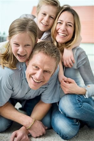 Happy family with two kids at home Stock Photo - Premium Royalty-Free, Code: 6121-07809726