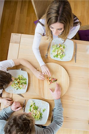 Family fighting for last slice of pizza Stock Photo - Premium Royalty-Free, Code: 6121-07809853