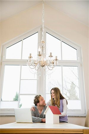 Couple with architectural model and laptop Stock Photo - Premium Royalty-Free, Code: 6121-07809878