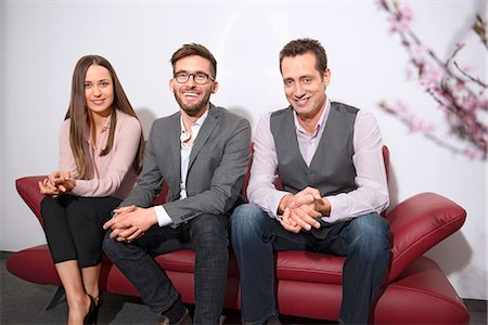 Three young business people waiting appointment Stock Photo - Premium Royalty-Free, Code: 6121-07809916