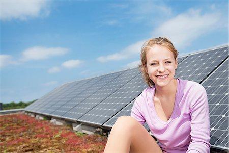 Teenage girl renewable energy solar panel Stock Photo - Premium Royalty-Free, Code: 6121-07810052