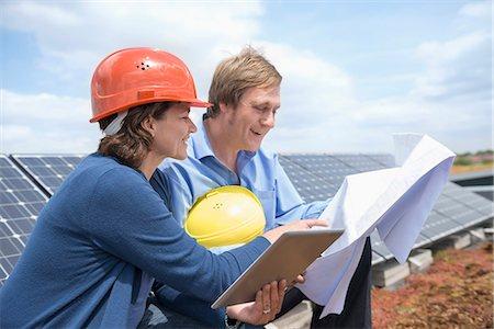 Meeting architect man woman blueprint solar energy Stock Photo - Premium Royalty-Free, Code: 6121-07810063