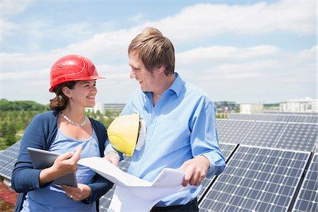 Female architect meeting client solar energy panel Stock Photo - Premium Royalty-Free, Code: 6121-07810062
