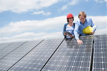 Client inspecting solar panel meeting architect Stock Photo - Premium Royalty-Free, Code: 6121-07810067