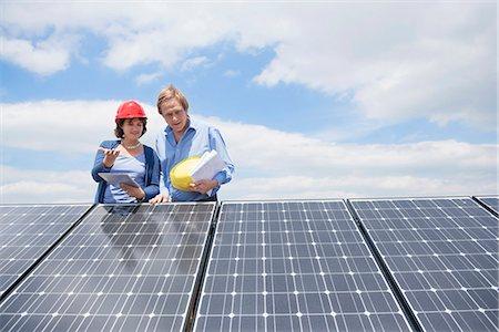 Photovoltaic panel architect female client Stock Photo - Premium Royalty-Free, Code: 6121-07810066