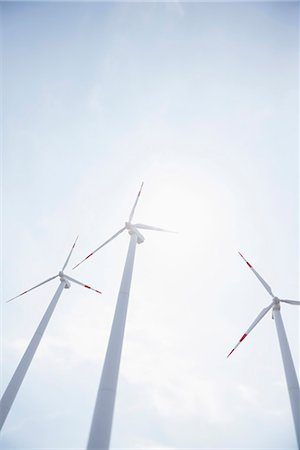 Three wind turbines energy electricity Stock Photo - Premium Royalty-Free, Code: 6121-07810073