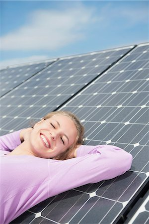 Relaxing happy green energy girl solar panel Stock Photo - Premium Royalty-Free, Code: 6121-07810074