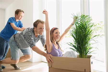 pushing - Family moving in home new house playing boxes Stock Photo - Premium Royalty-Free, Code: 6121-07810002