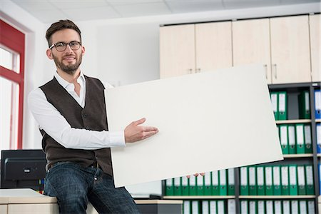 person holding sign - Young man office holding poster sign advert Stock Photo - Premium Royalty-Free, Code: 6121-07810031
