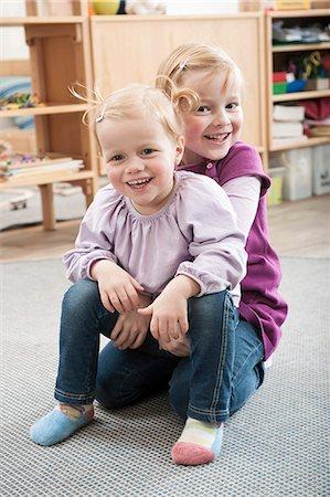 pantyhose kid - Portrait of two little sisters in kindergarten Stock Photo - Premium Royalty-Free, Code: 6121-07810100