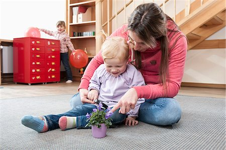 Female educator playing with little girl in kindergarten Stock Photo - Premium Royalty-Free, Code: 6121-07810108