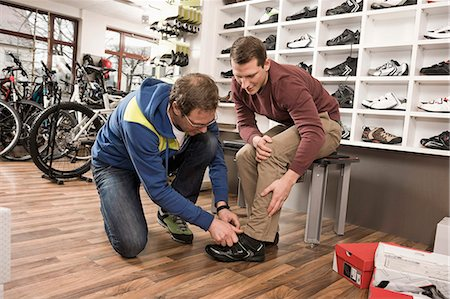 Man buying sports shoes Stock Photo - Premium Royalty-Free, Code: 6121-07810119
