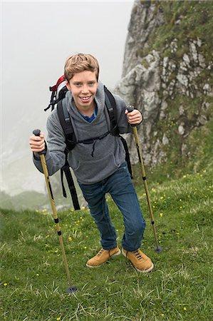 Teenage boy hiking in mountains Alps Stock Photo - Premium Royalty-Free, Code: 6121-07810253