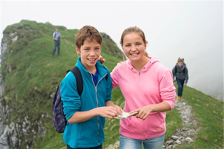 Portrait brother sister hiking in mountains Stock Photo - Premium Royalty-Free, Code: 6121-07810252