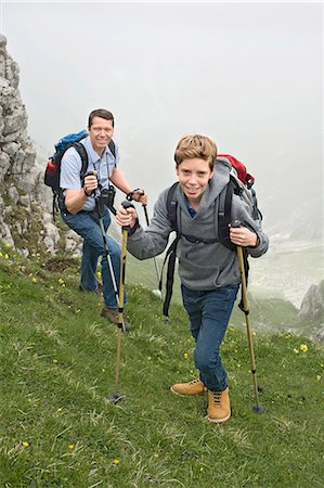 Father and son hiking in mountains Alps Stock Photo - Premium Royalty-Free, Code: 6121-07810254