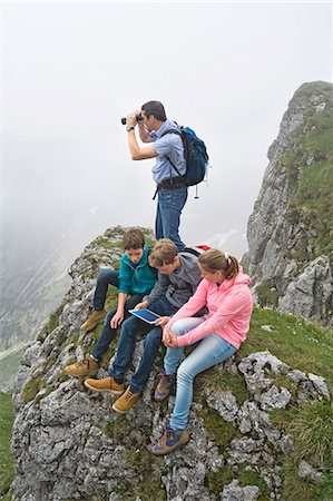 Father teenage kids using iPad in mountains Stock Photo - Premium Royalty-Free, Code: 6121-07810256
