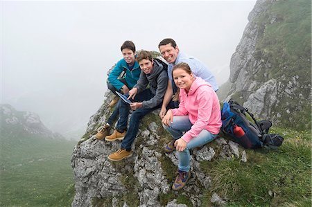 Father teenage kids using iPad in mountains Stock Photo - Premium Royalty-Free, Code: 6121-07810259