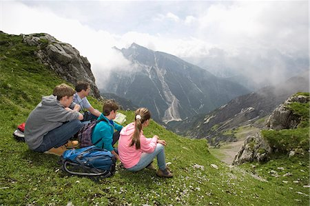 Father and kids looking at hiking map mountains Stock Photo - Premium Royalty-Free, Code: 6121-07810263