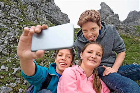 Girl and teenage boys self-portrait cell phone Stock Photo - Premium Royalty-Free, Code: 6121-07810261
