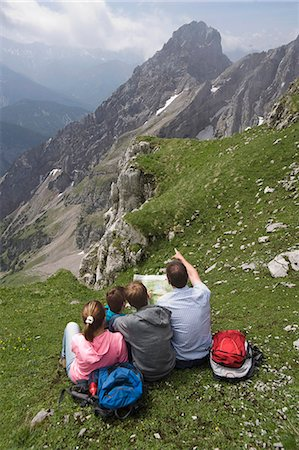 Father and kids looking at hiking map mountains Stock Photo - Premium Royalty-Free, Code: 6121-07810265