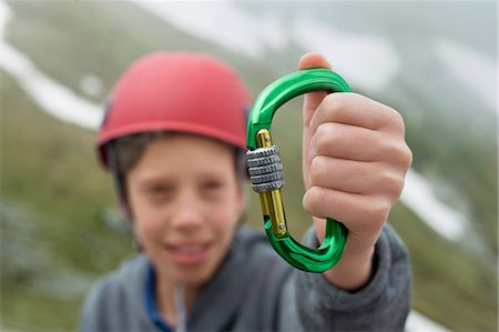 Young boy helmet holding climbing Carabiner Stock Photo - Premium Royalty-Free, Code: 6121-07810277
