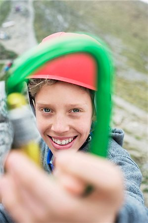 Young boy helmet holding climbing Carabiner Stock Photo - Premium Royalty-Free, Code: 6121-07810278