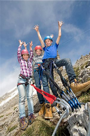 Three young teenagers mountain climbing Stock Photo - Premium Royalty-Free, Code: 6121-07810285