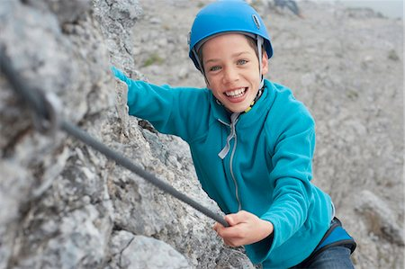 Young teenage boy helmet rope climbing safety Stock Photo - Premium Royalty-Free, Code: 6121-07810289