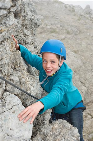 Smiling young teenager climbing helmet rope Stock Photo - Premium Royalty-Free, Code: 6121-07810290